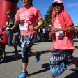 Participants crossing the finish line with a smile.