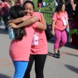 Participants hug after completing the race.