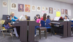 Students practice piano in their biweekly lesson. Photo from U Piano Outreach website