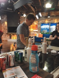 He preps his equipment, which for a soda shop owner, includes Torani syrups, cups, soda cans, fliers, etc.