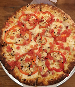 Customers love the Village Baker's Chicken Alfredo pizza, making it the best-selling pizza.