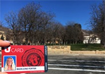 The reporter's UCard in front of President's Circle, where Kingsbury Hall is located.
