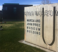Utah Museum of Fine Arts sign with the museum in the background.