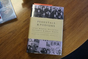 Pedestals & Podiums, a book written by Dr. Martha Bradley on the history of Mormon feminism. It includes topics like the Equal Rights Amendment and creation of the Relief Society.