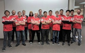 "University of Utah ""League of Legends"" esport team front row left to right: Ryan ""Ethoe"" Outtrim, Conner ""Soulrush"" Soule, Tanden ""Tanden"" Peterson, Thomas ""Kraedon"" Nguyen, Josh ""AdamJosh11"" Adams, James ""Jayms"" Tran, and head coach Kenny ""Sindrichaos"" Green. Back row left to right: Michael ""Swish"" Swisher, Kyle ""Giraffe"" Hibler, Steven ""Omgitscookietime"" Pasinsky, Garrett ""Imthenova"" Bina, Mingyang ""Mingy"" Zhang, Alec ""Reyne"" Tran, and Mackinley ""Drakar"" Nguyen"