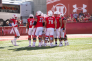 University of Utah Offense huddles to hear the next play call.