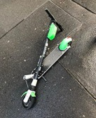 Broken scooters like this one are scattered all over the city.