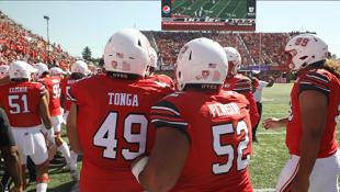 Pita Tonga and John Penesini waiting to go attack the opponent's offense.