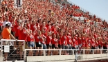 The MUSS student section cheering on the football team.